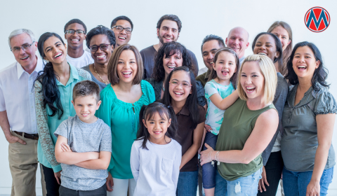 A group of diverse people of different ages smiling