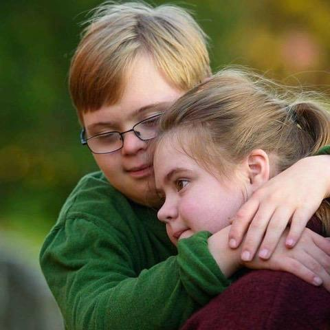 [IMAGE DESCRIPTION: A photo of a young teen brother and sister hugging.]