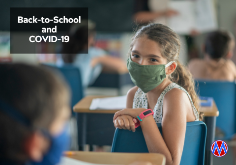 Girl wearing mask in class