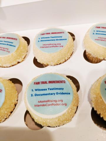 [IMAGE DESCRIPTION: A photo of cupcakes with an impeachment message in the frosting.]