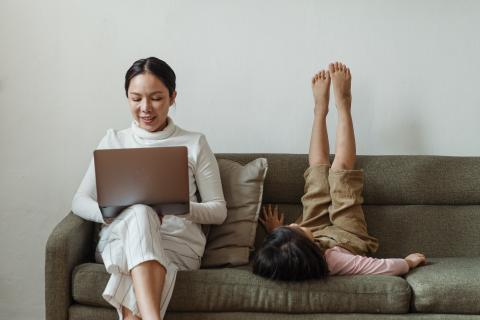 Mom on computer with daughter