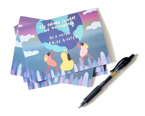 [IMAGE DESCRIPTION: A photo of postcards and a black pen.]