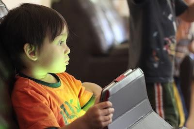 child looking at tablet