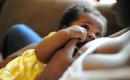 [photo of a baby breastfeeding]