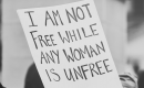 A protest poster that says 'I am not free while any woman is unfree'