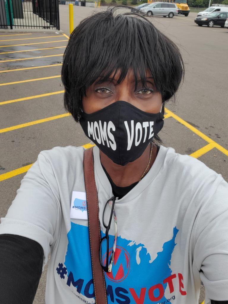 Woman wearing MomsVote mask