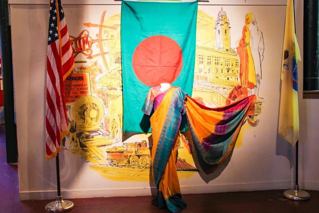 A traditional sari welcomes museum guests
