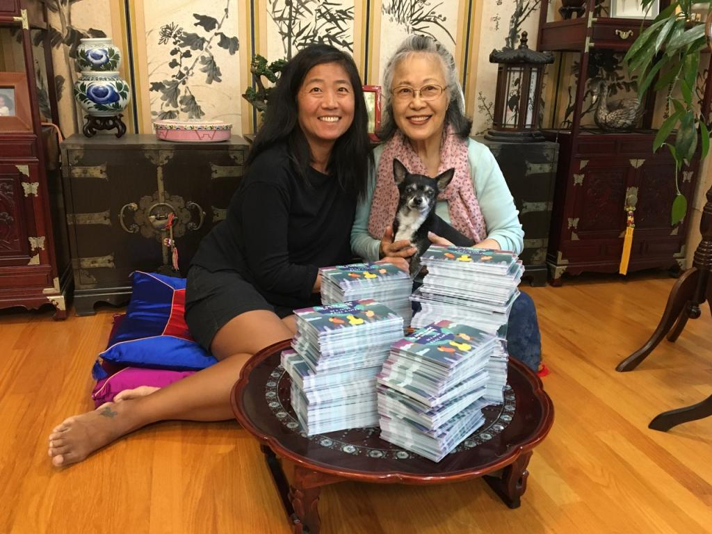 Photo of a mother and daughter and their stack of MomsVote voter poscards 2020