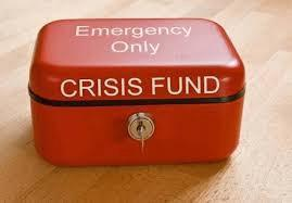 "A photo of a red box that says ""Emergency Only: CRISIS FUND"" with a lock and key."