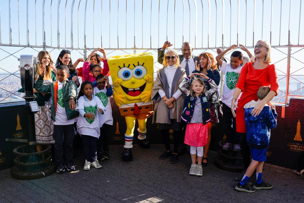 Children pose with Spongebob Squarepants at the Empire State Building for Lights On Afterschool.