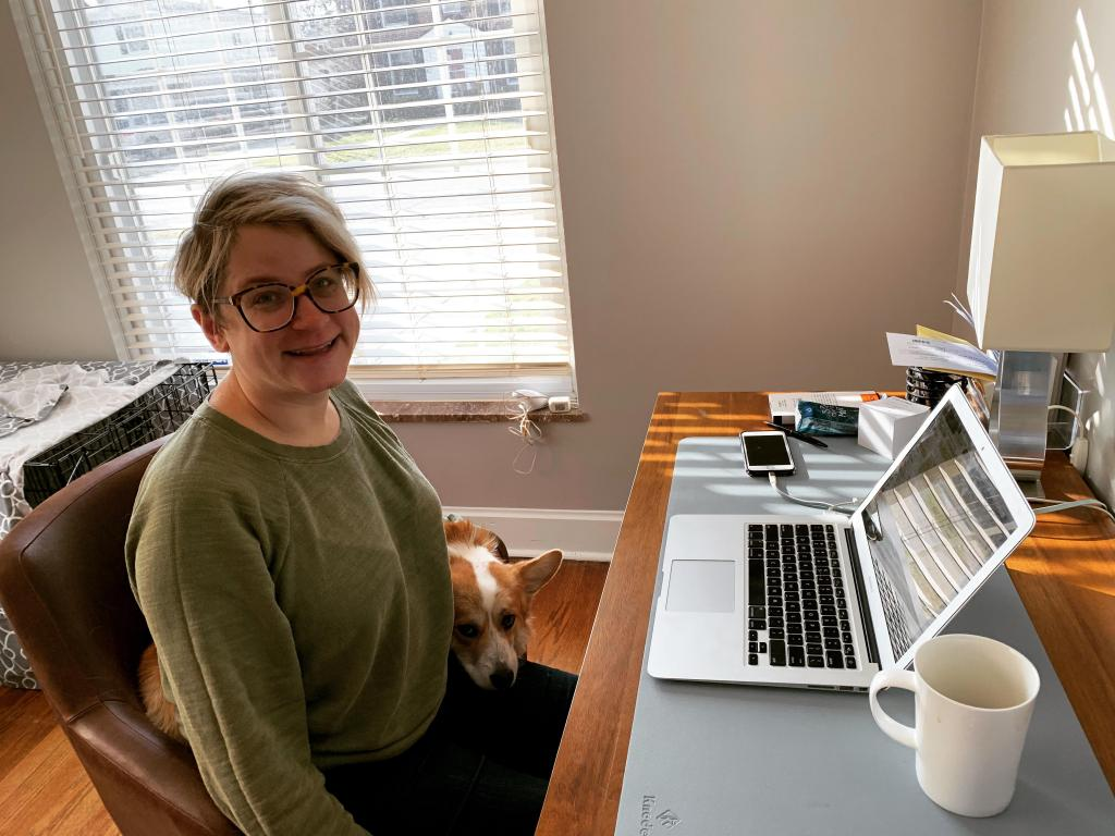 [IMAGE DESCRIPTION: A photo of MomsRising's Elyssa Schmier with her corgi, Ziggy.]
