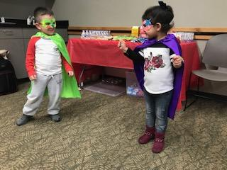 Superhero kids advocating for family-friendly policies and programs