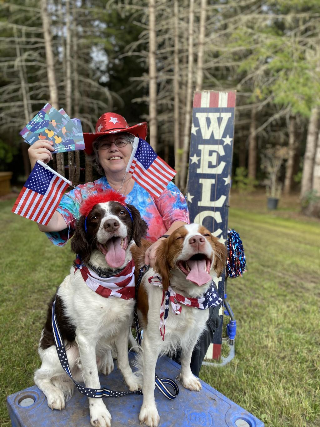 Photo of MomsVote volunteer 2020 with her dogs and American flag