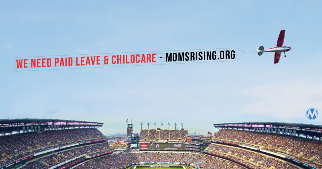 """Airplane flying over a stadium pulling a banner reading """"We need paid leave & childcare"""""""