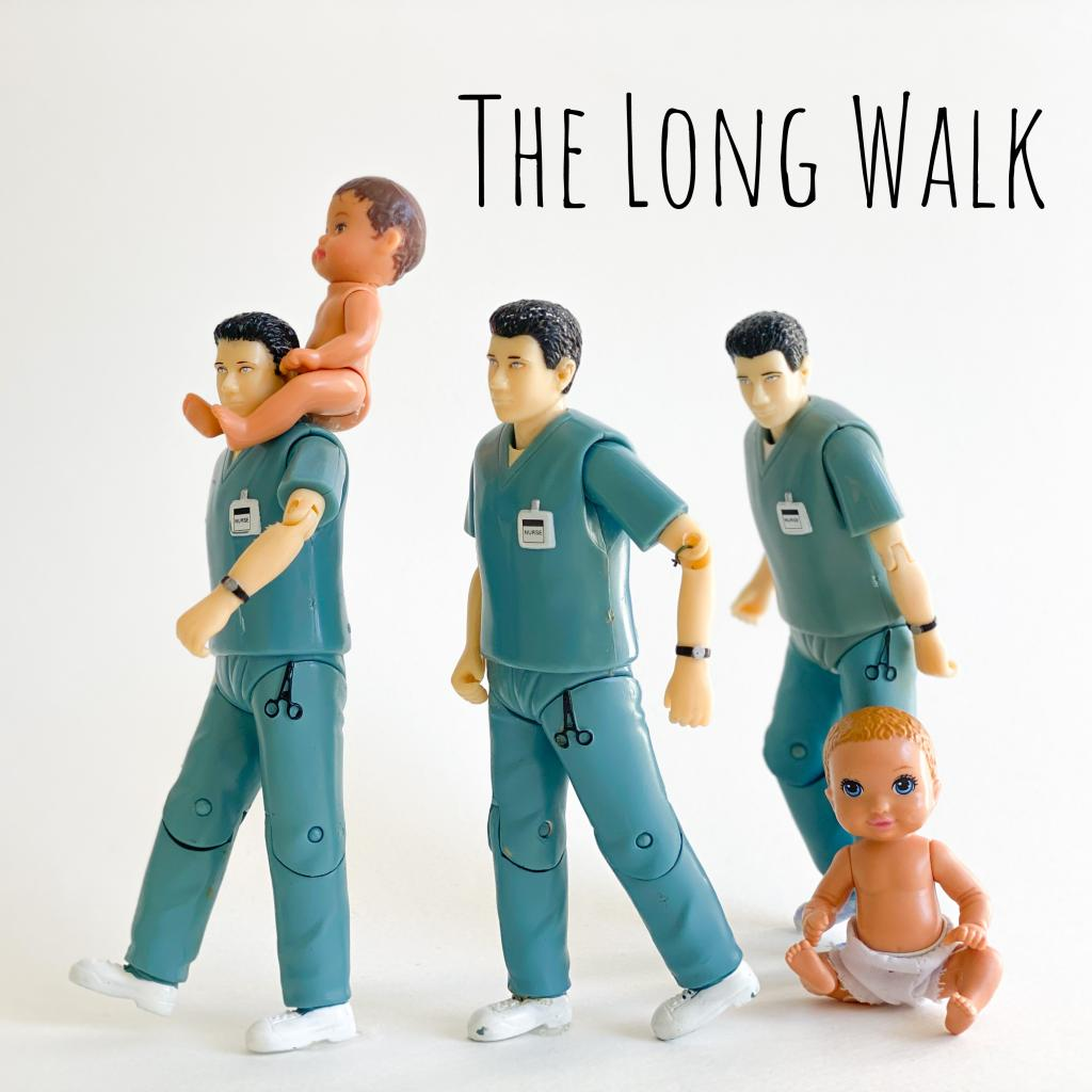 [IMAGE DESCRIPTION: A photo of small plastic dolls arranged to look like they're in a line, walking, with a baby doll perched on a nurse daddy doll's shoulders.]