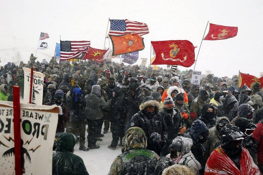 [IMAGE DESCRIPTION: A group of veterans joins the water protectors at Standing Rock.]