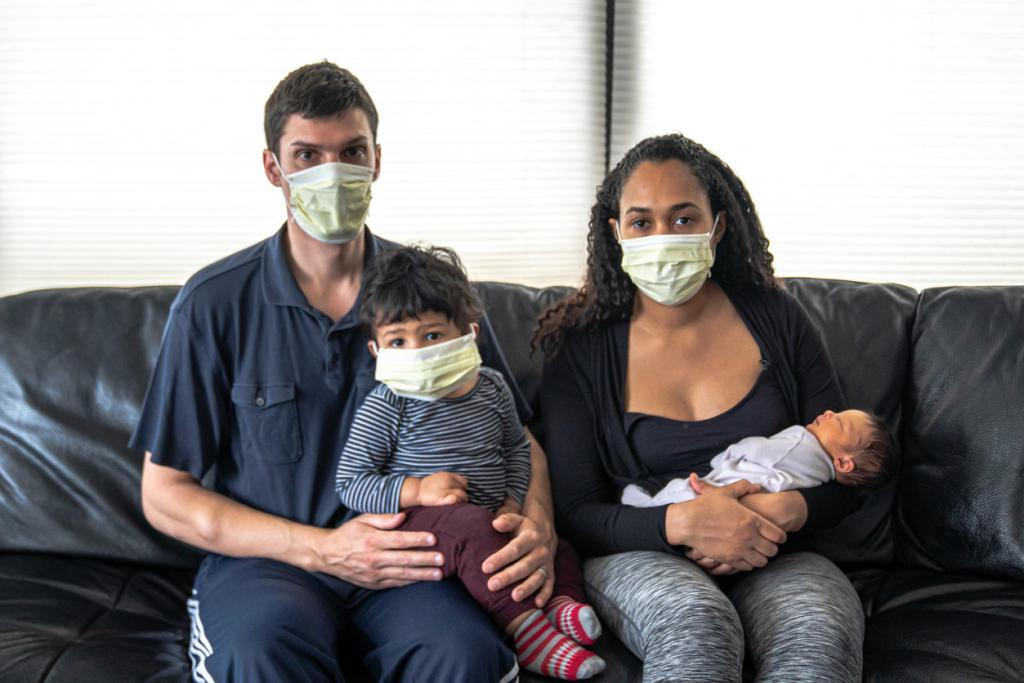 Family wearing medical masks