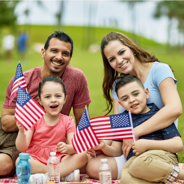Latinx-American family holding U.S. flags