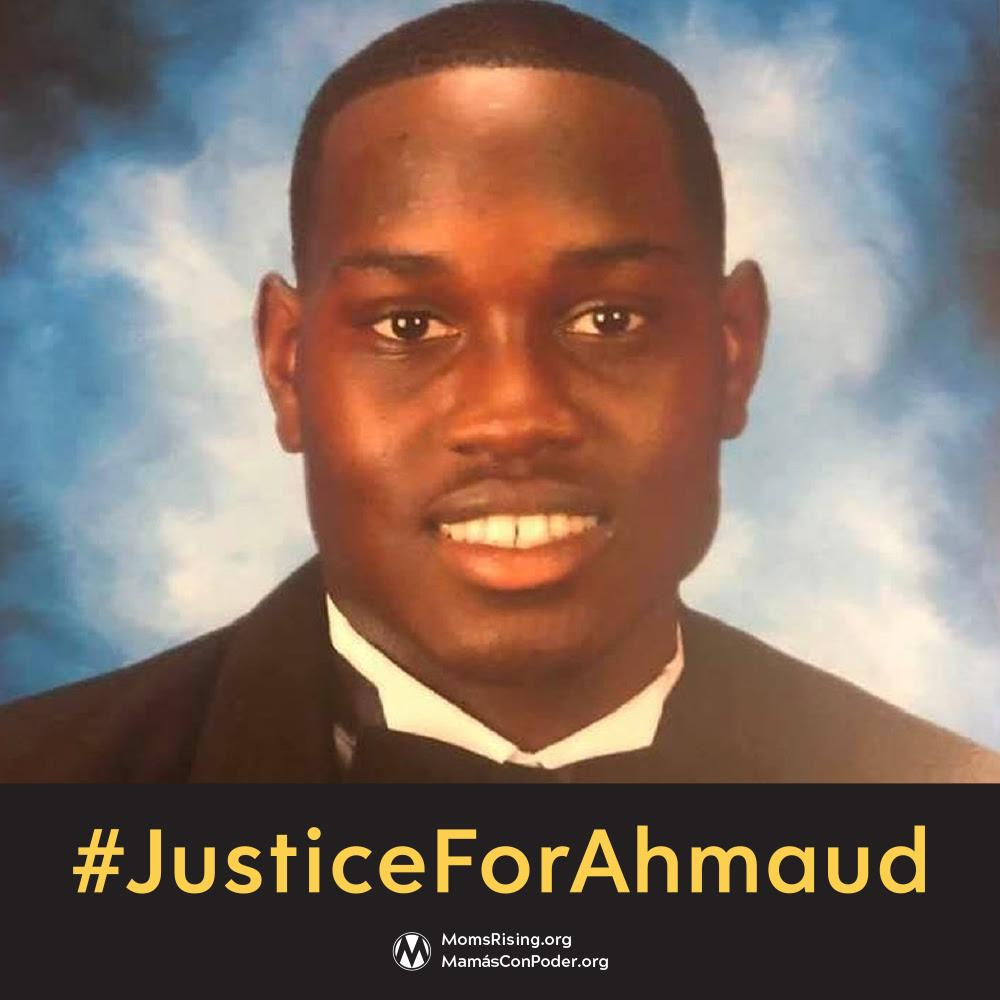 [IMAGE DESCRIPTION: A photo of a young Black man smiling at the camera, wearing a tuxedo, with the words Justice For Ahmaud underneath.]