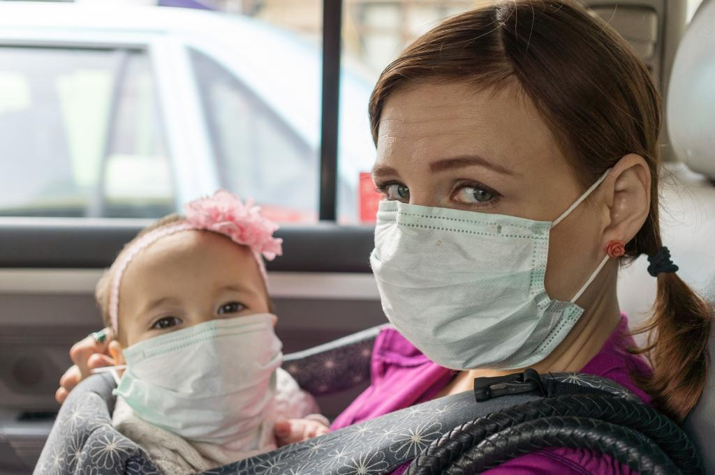 mom and baby wearing medical mask