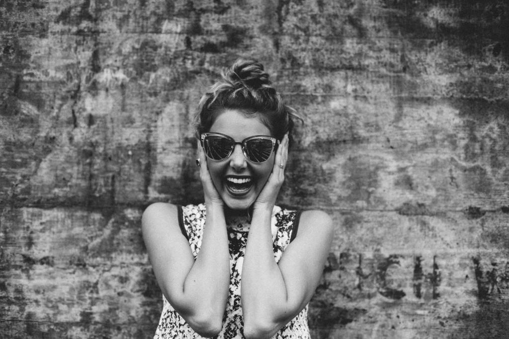 woman smiling in sunglasses