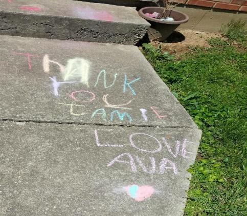[IMAGE DESCRIPTION: A photo of a sidewalk with a thank you message written in chalk]