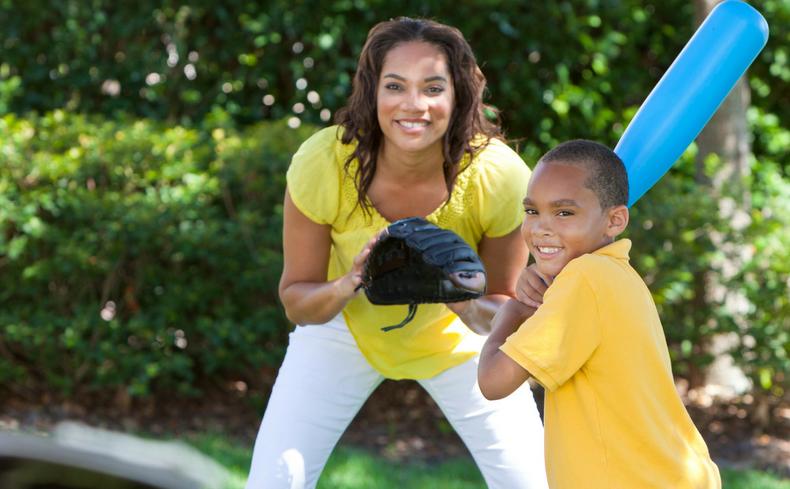 boy playing baseball with mom