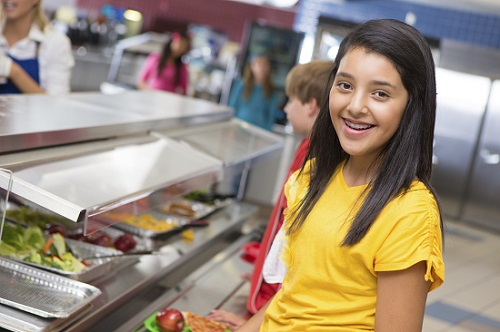 Latina Girl in Snack Line | MomsRising.org