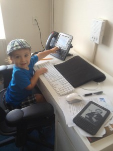 Isaac's son Caleb sees where his Dad works, promptly gets on Dad's chair and starts making calls. Summer 2013.